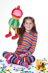 Young girl with plush toys