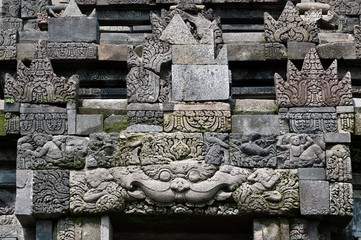 Carved stone at old Buddhist temple, Java, Indonesia