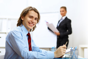 Young businessman at work in office