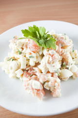 Fresh salad made of salmon peaces, eggs and herbs - Ducan diet