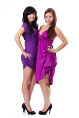 Two young women in violet dresses