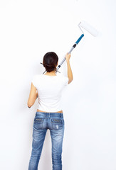 Young woman with paint brushes