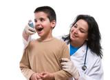 Medical doctor applying oxygen treatment on asthma boy