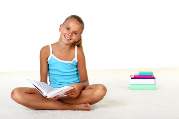 Pretty teenage girl with books