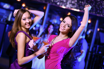 Young woman having fun at nightclub disco