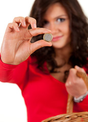 young woman with money, euro coin, focus on foreground