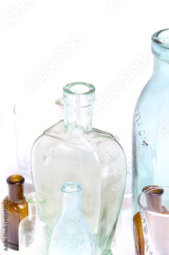 Vintage glass bottles on white