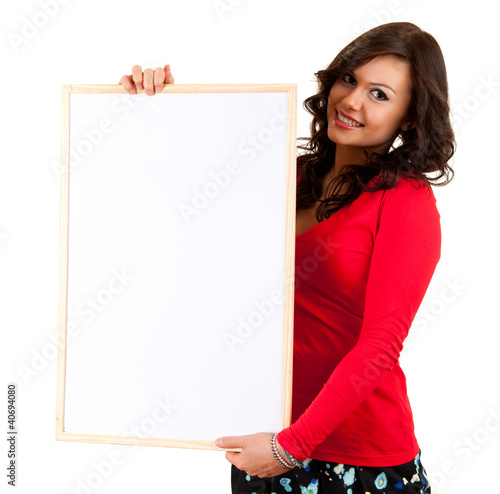smiling young woman with blank billboard, white background