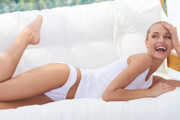 Laughing woman in panties and shirt