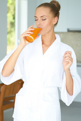 Woman enjoying a glass of orange juice