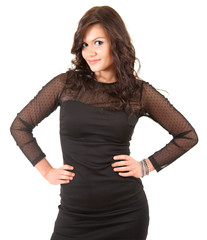 elegant young woman in black dress with hands on waist