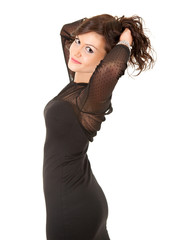 smiling elegant girl in black dress with raised arms
