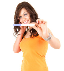 happy young woman and positive pregnancy test