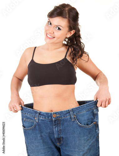 young woman showing how much weight she lost