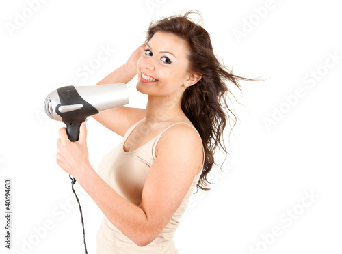 human fashion - beautiful girl drying her hair by dryer