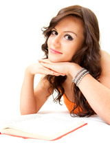 smiling student girl with book looking at camera