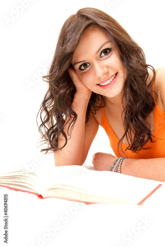 cheerful student young woman with book looking at camera