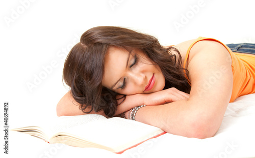 tired student girl sleeping near the book, white background