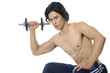 young fit man lifting weights doing bicep curls over white