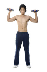 Fit young body builder exercising with a dumbbell