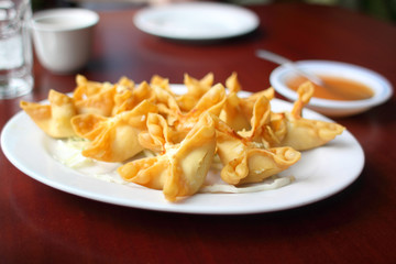 Plate of crab puffs at a Chinese restaurant.