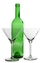 Empty green bottle and glasses