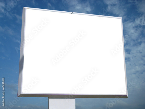 Outdoor advertising billboard on blue sky