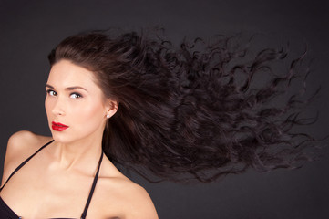Woman with flying hair isolated