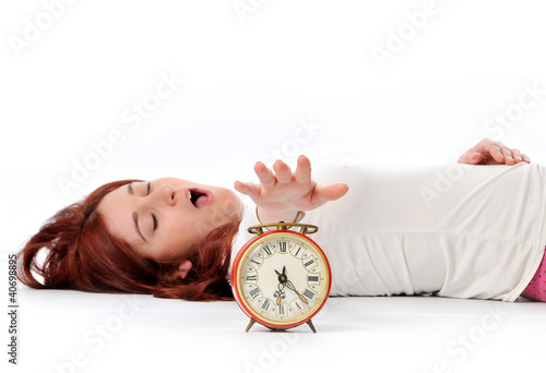 a woman's hand presses the button of clock