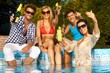 Cheerful people by swimming pool