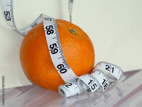 Orange surrounded yardstick