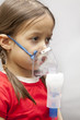 little girl with nebulizer