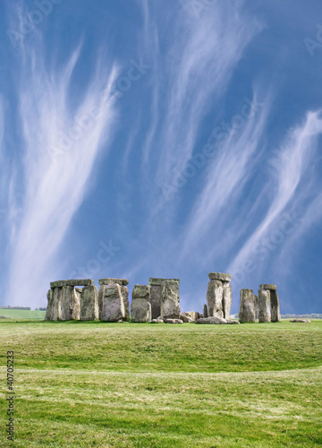 Stonehenge on green grass under blue sky