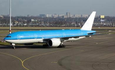 Big blue plane taxiing