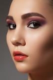 Purple eye makeup, perfect strong brows and gloss lips make-up poster