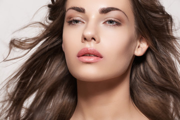 Sensual woman model with windswept flying brunette hair