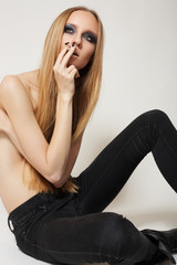 Fashionable young woman model. Rock style with dark make-up