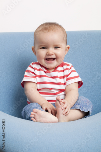 happy toddler with bare feet