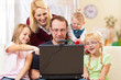 Family with computer having video conference