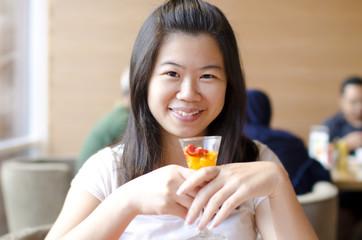 Asian woman enjoying her dessert