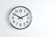 Leinwandbild Motiv Silver shiny clock hanging at the wall with copy space