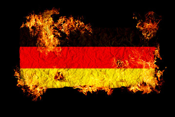 German flag in fire.