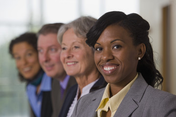 Hispanic businesswoman smiling with her colleagues