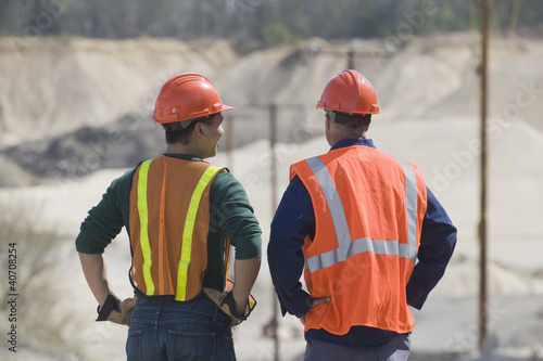 Two engineers at a gravel and asphalt plant
