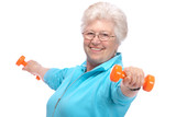 Fototapety Senior woman working with weights in gym