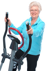 senior woman exercising on stepper
