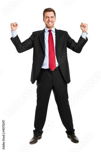 Businessman raising up arms in sign of victory