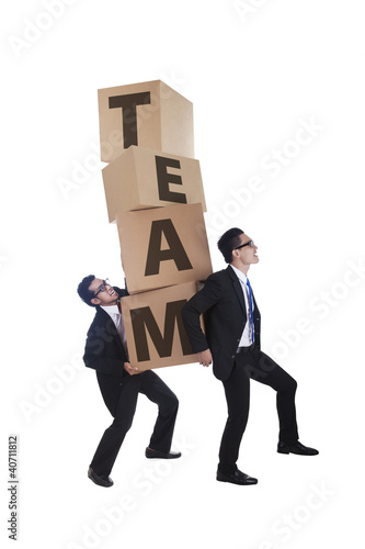 Business team walking up with boxes