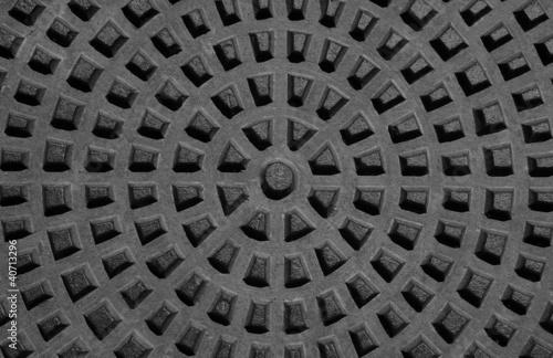 Staande foto Leder Rusty city manhole cover