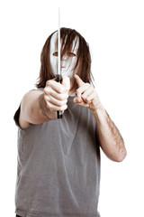 Scary masked man menacing